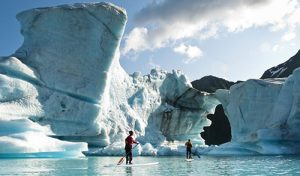 Stand Up Paddling in Bear Glacier Kenai Fjords Alaska.